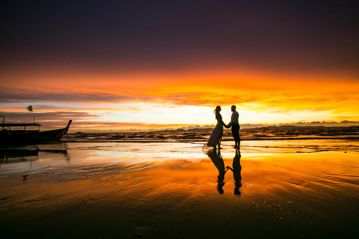 Honeymoon photography for Mike with Justine on beauiful beach during sunset Krabi Thailand.